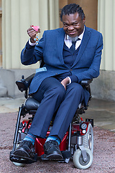 Artist Yinka Shonibare proudly displays his OBE for services to art awarded at an investiture ceremony conducted by Prince William, Duke of Cambridge at Buckingham Palace. London, May 09 2019.
