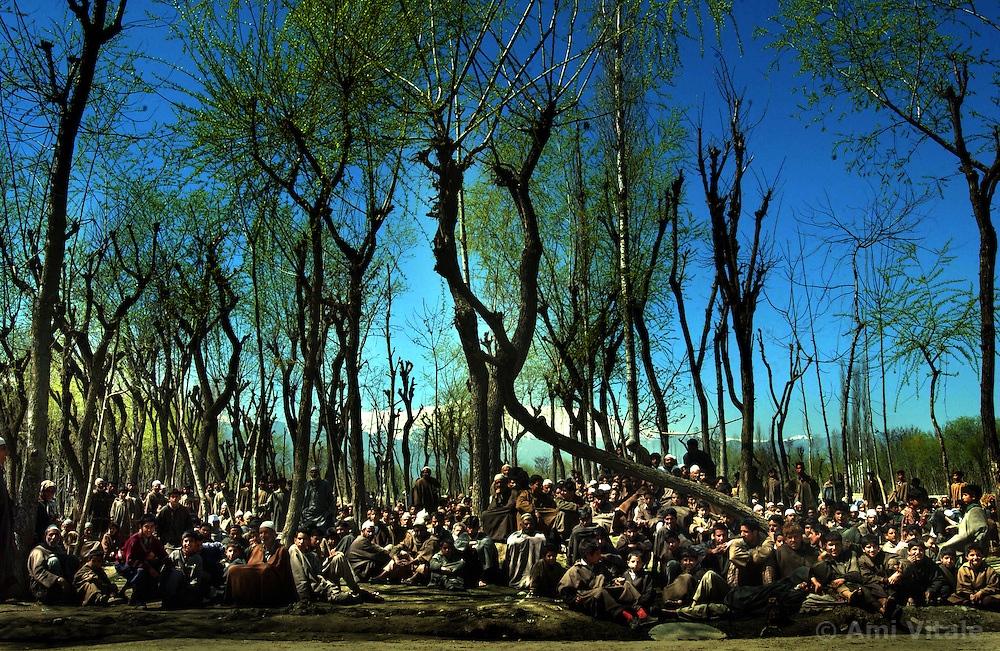 Hundreds of  villagers sit  outside their homes after Indian soldiers search for a militant, March 28, 2002  in Budgam district west of Srinagar. The militant hid in a mosque in a 20-hour siege. It was the fourth time in two months that separatists had sought refuge in a mosque in the Himalayan region. .