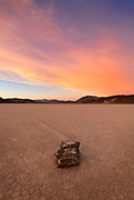 The moving rocks of the Racetrack in Death Valley National Park, California, USA during sunset.