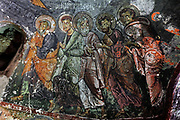 Apostles, fresco, 9th - 11th century, in Karabas Kilise, or the Black Head Church (as the painted figures have been blackened by smoke from oil lamps), in the Soganli Valley in Goreme, in Nevsehir province, Cappadocia, Central Anatolia, Turkey. The churches in Goreme are carved from the soft volcanic tuff created by ash from volcanic eruptions millions of years ago. Early christians came here to flee persecution by the Romans and others settled here under the influence of early saints. This area forms part of the Goreme National Park and the Rock Sites of Cappadocia UNESCO World Heritage Site. Picture by Manuel Cohen