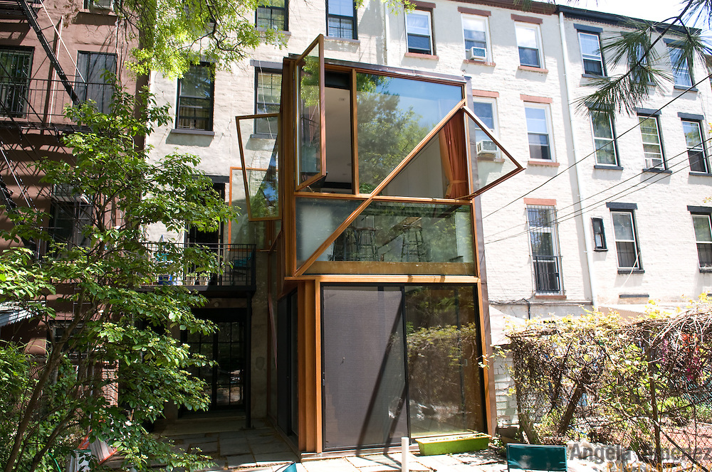 Date: 5/8/11.Desk: REA.Slug: 15COVER5.Assign Id: 10111168E..The home of Jed Marcus and Jessica Greenbaum, a four-story 1874 brownstone with a 2009 back addition by design architect Christopher McVoy located in Fort Greene, Brooklyn, is photographed on May 8, 2011. They live there with their daughters Becki, 13, and Bella, 16, who is away at boarding school. ..This is view of the back of the house from the garden area. ..Photo by Angela Jimenez for The New York Times .photographer contact 917-586-0916