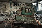 Chilling tour in the haunting remains of the Chernobyl site 30 years on <br /> <br /> When 29 years ago a mile-tall blue flame shot high into the sky, burning a hole in the ozone layer, the eyes of the world focused on the human-made volcano - Soviet Reactor 4 of the Chernobyl Nuclear Plant - spewing 400 times more radioactive load than the bomb dropped on Hiroshima. <br /> It was the Cold War, so American satellites were zooming in on the plant, now with a glowing red spot, much like a fresh gunshot wound on Earth's surface, bleeding plutonium.<br /> 'We did not know that death could be so beautiful,' said those who saw it from the model Soviet town of Pripyat, built specially for the employees of the plant, clean and church-less. <br /> <br /> Ukraine is holding commemorations to mark the 30th anniversary of the nuclear disaster in Chernobyl.<br /> Sirens were sounded at the same moment as the first explosion at the reactor, in the early hours of 26 April 1986.<br /> The meltdown at the plant remains the worst nuclear disaster in history.<br /> An uncontrolled reaction blew the roof off, spewing out a cloud of radioactive material which drifted across Ukraine's borders, into Russia, Belarus and across a swathe of northern Europe.<br /> ©Michal Huniewich/Exclusivepix Media