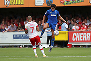 AFC Wimbledon defender Will Nightingale (5) battles for possession with Rotherham United Kyle Vassell (7) during the EFL Sky Bet League 1 match between AFC Wimbledon and Rotherham United at the Cherry Red Records Stadium, Kingston, England on 3 August 2019.
