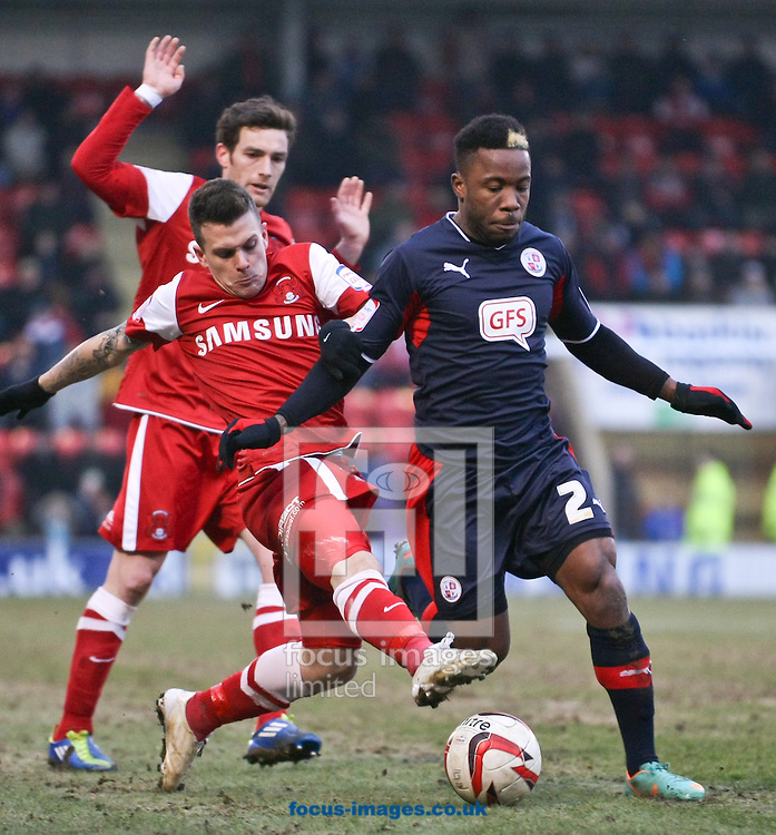 Picture by David Horn/Focus Images Ltd +44 7545 970036.23/02/2013.Dean Cox of Leyton Orient challenges Mustapha Dumbuya of Crawley Town during the npower League 1 match at the Matchroom Stadium, London.