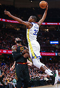 CLEVELAND, OH - JANUARY 15: Kevin Durant #35 of the Golden State Warriors goes up for the dunk over LeBron James #23 of the Cleveland Cavaliers at Quicken Loans Arena on January 15, 2018 in Cleveland, Ohio. NOTE TO USER: User expressly acknowledges and agrees that, by downloading and or using this photograph, User is consenting to the terms and conditions of the Getty Images License Agreement.(Photo by Michael Hickey/Getty Images) *** Local Caption *** Kevin Durant; LeBron James