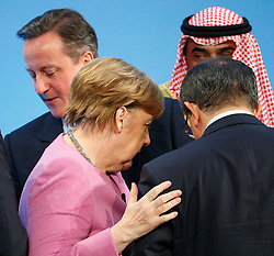 © Licensed to London News Pictures. 04/02/2016. London, UK. Prime Minister David Cameron, Chancellor of Germany Angela Merkel, Emir of Kuwait Sabah Al Ahmad Al Sabah and Turkish Prime Minister Ahmet Davutoglu speaking at a press conference at 'Supporting Syria and the Region Conference' in London on February 4, 2016. Photo credit: Tolga Akmen/LNP