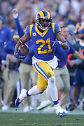 Dec 30, 2018; Los Angeles, CA, USA; Los Angeles Rams cornerback Aqib Talib (21) runs with the football after an interception at Los Angeles Memorial Coliseum. The Rams defeated the 49ers 48-31.  (Robin Alam/Image of Sport)