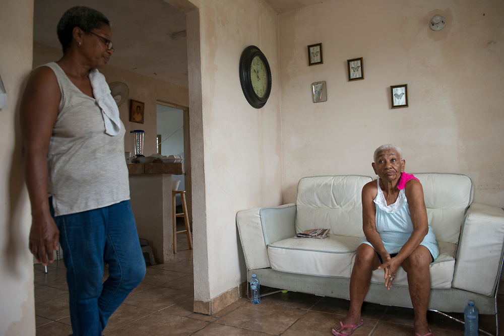 Punto Santiago, PR--Teófila Delgado and for daughter, Carmen Camacho inside their home, November 8, 2017. Carmen, her mother, and five additional family members stayed in their home to ride out Hurricane Maria because her mother refused to leave. At about 6:00 AM on September 20, 2017, their home flooded quickly and they had to escape out of a bedroom window and move to the second floor of their home, which by that time had no roof. For the next six hours, they were exposed to a hurricane, whose eastern wall passed over their community. Photo by Lori Waselchuk/braf.org