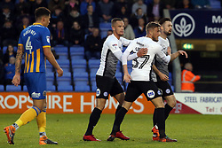 Gwion Edwards of Peterborough United (centre) celebrates scoring the opening goal of the game - Mandatory by-line: Joe Dent/JMP - 24/04/2018 - FOOTBALL - Montgomery Waters Meadow - Shrewsbury, England - Shrewsbury Town v Peterborough United - Sky Bet League One