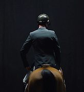 Jonathon Millar (CAN) riding Bonzay waits in the hitching ring during the 2nd round of the Greenhawk Canadian Championship at The Royal Horse Show, TORONTO, CANADA.  November 5 2016