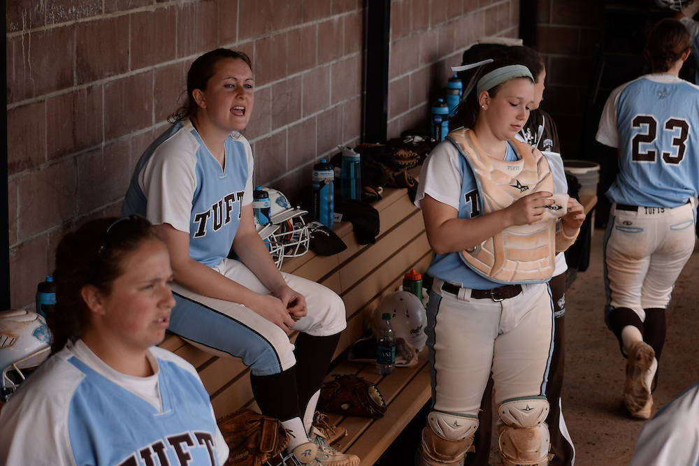 4/1/16 – Medford/Somerville, MA –Teammates watch from the dugout during Softball's 7-5 win against Bowdoin on April 1, 2016. (Sofie Hecht / The Tufts Daily)
