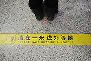 """XI'AN, CHINA - DECEMBER 13: (CHINA OUT) <br /> <br /> Mistranslations  In China<br /> <br /> The sign """"Please wait behind the yellow line"""" is mistranslated into """"Please wait outside a noodle"""" at Xi'an North Station on December 13, 2014 in Xi'an, Shaanxi province of China. Many signs of Xi'an North Station has been mistranslated and brought many inconvenience to the foreign passengers.<br /> ©Exclusivepix Media"""