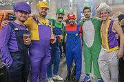 Dart fans in fancy dress during the World Darts Championship at Alexandra Palace, London, United Kingdom on 1st January 2016. Photo by Shane Healey.