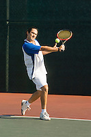 Tennis Player Hitting Backhand
