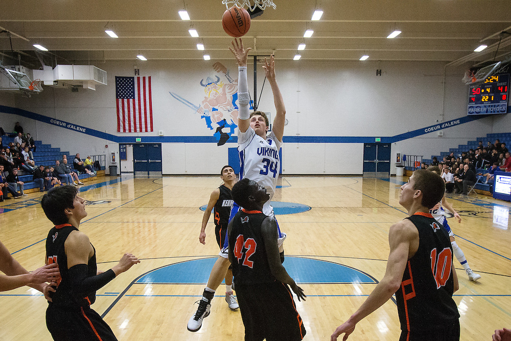 GABE GREEN/Press<br /> <br /> Coeur d&rsquo;Alene junior forward Tony Naccarato lets the ball fly to the hoop in the fourth quarter of Saturday&rsquo;s game against Kennewick.