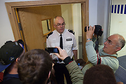© Licensed to London News Pictures . 21/08/2012 . London , UK . A senior police officer speaks to protesters inside Brixton police station . Video has emerged of a man being detained in Brixton on Sunday ( 19th August ) during which it is alleged police officers stamped on the  man's head . Protesters march from Lambeth Town Hall to Brixton police station and deliver a formal complaint about the incident to the front counter . Photo credit : Joel Goodman/LNP