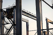 Officials from Konecranes and the Georgia Ports Authority commemorated the 1,000th rubber-tired gantry crane produced by the company, and completion of the latest phase of GPA's electric RTG infrastructure. The eRTGs use 95 percent less diesel than standard RTGs, saving on fuel costs and emissions.  (GPA Photo/Stephen Morton)