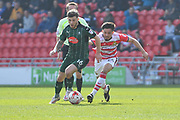 Plymouth Argyle midfielder Matthew Kennedy (16) and Niall Mason (24) Doncaster Rovers midfielder  during the EFL Sky Bet League 2 match between Doncaster Rovers and Plymouth Argyle at the Keepmoat Stadium, Doncaster, England on 26 March 2017. Photo by Ian Lyall.