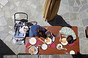 South Tyrol. Toblach/Kandellen (Dobbiaco/Gandelle). Seiterhof restaurant and hotel. A family having Penne at the terrace.