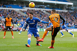 Sean Morrison of Cardiff City blocks a dhot from Rajiv van La Parra of Wolverhampton Wanderers - Photo mandatory by-line: Rogan Thomson/JMP - 07966 386802 - 28/02/2015 - SPORT - FOOTBALL - Cardiff, Wales - Cardiff City Stadium - Cardiff City v Wolverhampton Wanderers - Sky Bet Championship.