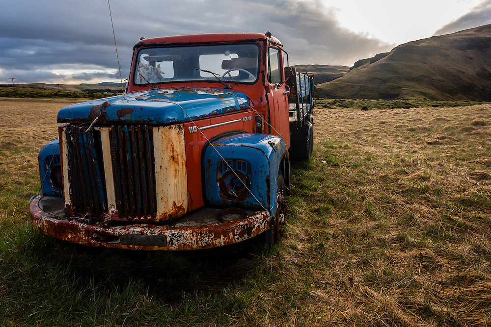 This red and blue truck is one of the many abandoned vehicles at Holmur