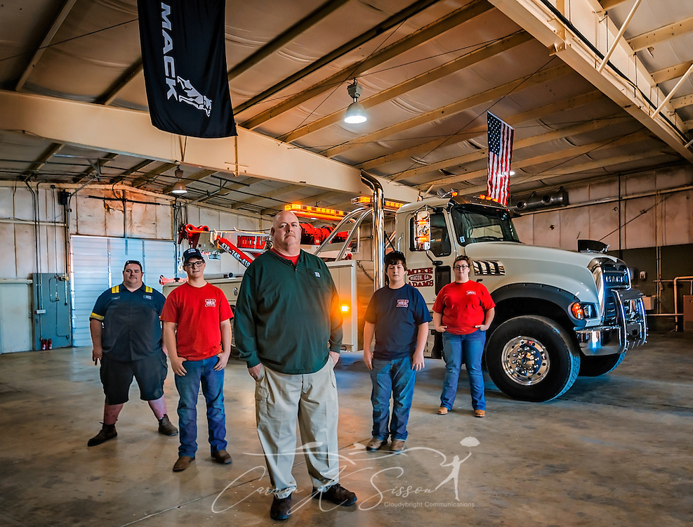 Mike Adams, of Mike Adams Towing and Air Cushion Recovery, poses with his children beside his newest truck, a 2016 Mack Granite with a 50-ton Century rotator, March 22, 2016, in Macon, Georgia. Adams is teaching the children about the business so that they can someday take over. From left are, Lane Adams, Matthew Adams, Mike Adams, Mack Adams and Megan Adams. (Photo by Carmen K. Sisson/Cloudybright)