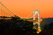 The George Washington Bridge, looking towards the New Jersey side, seen at sunset from Manhattan, New York City.