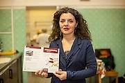 Managerin Lela Kukava aus Georgien mit der Speisekarte in der Küche des Ethnocatering Service in Prag.
