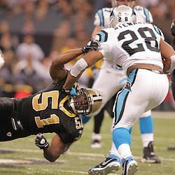 2008 December, 28: New Orleans Saints linebacker Jonathan Vilma (51) grabs Carolina Panthers running back Jonathan Stewart (28) during a week 17 game between NFC South divisional rivals the Carolina Panthers and the New Orleans Saints at the Louisiana Superdome in New Orleans, LA.