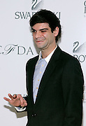 Jewelry designer Justin Giunta poses at the 2008 CFDA Fashion Awards Nominee Announcement in the Rooftop Gardens at Rockefeller Center  in New York City, USA on March 10, 2008.