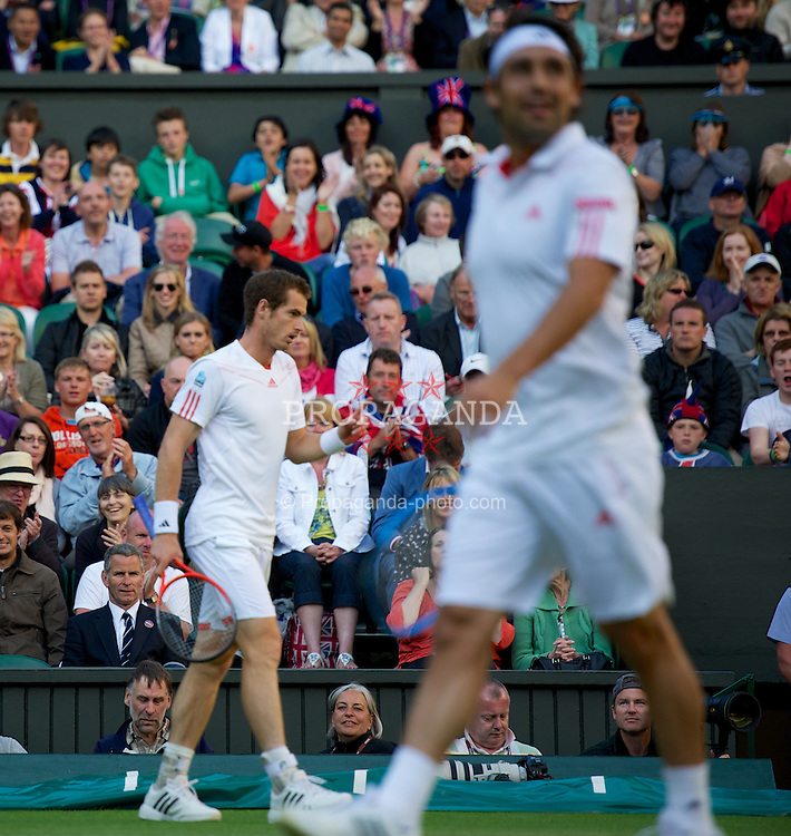 LONDON, ENGLAND - Saturday, June 30, 2012: Andy Murray (GBR) crosses ontoMarcos Baghdatis' (CYP) side of the court during the Gentlemen's Singles 3rd Round match on day five of the Wimbledon Lawn Tennis Championships at the All England Lawn Tennis and Croquet Club. (Pic by David Rawcliffe/Propaganda)