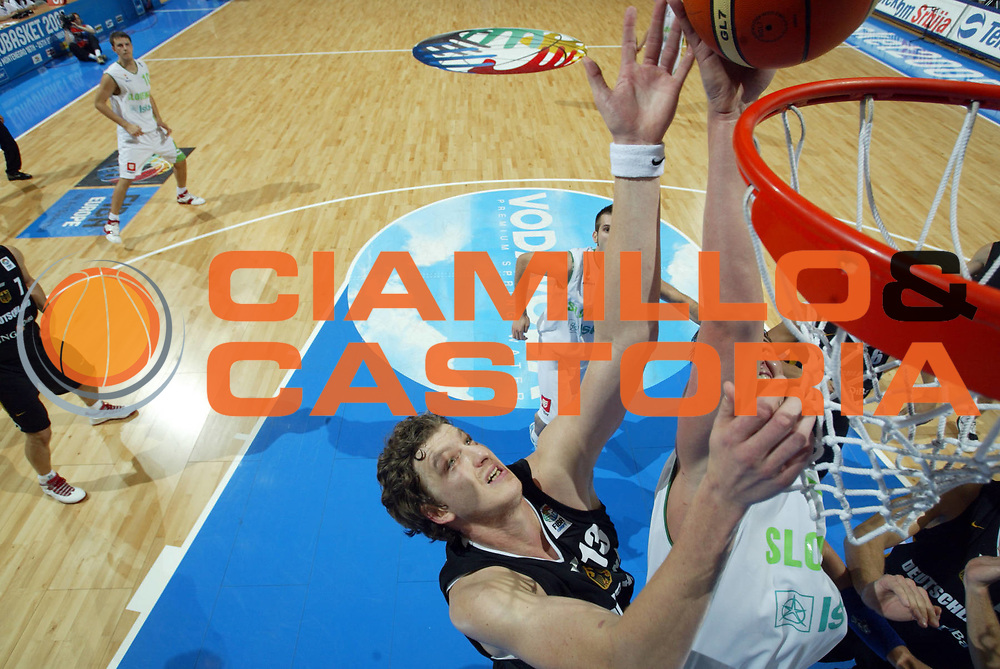 DESCRIZIONE : Belgrado Belgrade Eurobasket Men 2005 Germania Slovenia<br /> GIOCATORE : Femerling Jurak<br /> SQUADRA : Germania Slovenia Germany<br /> EVENTO : Eurobasket Men 2005 Campionati Europei Uomini 2005<br /> GARA : Germania Slovenia Germany Slovenia<br /> DATA : 23/09/2005<br /> CATEGORIA :<br /> SPORT : Pallacanestro<br /> AUTORE : Ciamillo&amp;Castoria/Fiba Europe Pool