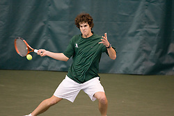 Keziel Juneau (William and Mary) hits a forehand during the #1 doubles match.  The #1 ranked Virginia Cavaliers men's tennis team faced the #43 ranked William and Mary Tribeat the Boyd Tinsley Courts at the Boars Head Inn in Charlottesville, VA on January 20, 2008.