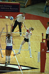22 October 2006: Lindley McDavid powers the ball over the hands of Danielle Diehl. Illinois State University swept Evansville in 3 straight games of a best of 5 match. The Evansville Purple Aces met the Redbirds of Illinois State at Redbird Arena on the campus of Illinois State University in Normal Illinois.<br />
