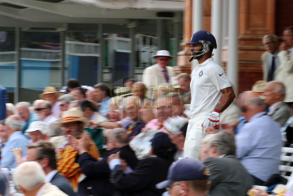 Shikhar Dhawan of India leaves the pavilion during day three of the 2nd Investec test match between England and India held at Lords cricket ground in London, England on the 19th July 2014<br /> <br /> Photo by Ron Gaunt / SPORTZPICS/ BCCI