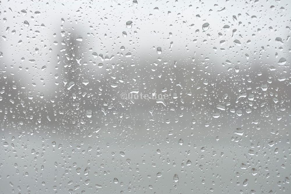 a window with rain drops