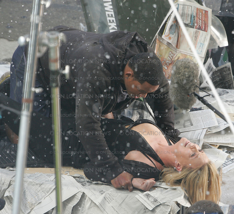 "Los Angeles, CALIFORNIA - Saturday 11th August 2007. NON EXCLUSIVE: Charlize Theron and Will Smith film a very physical as well as emotional scene. In the scene Superhero Will has just crashed landed from flying with Charlize against her will. After landing the two wrestle and fight as Charlize keeps yelling ""I hate you"" to and she and begins to cry. In the movie these two fall in love. Photograph: Buchan/Ford/On location News. Sales: Eric Ford 1/818-613-3955 info@OnLocationNews.com"