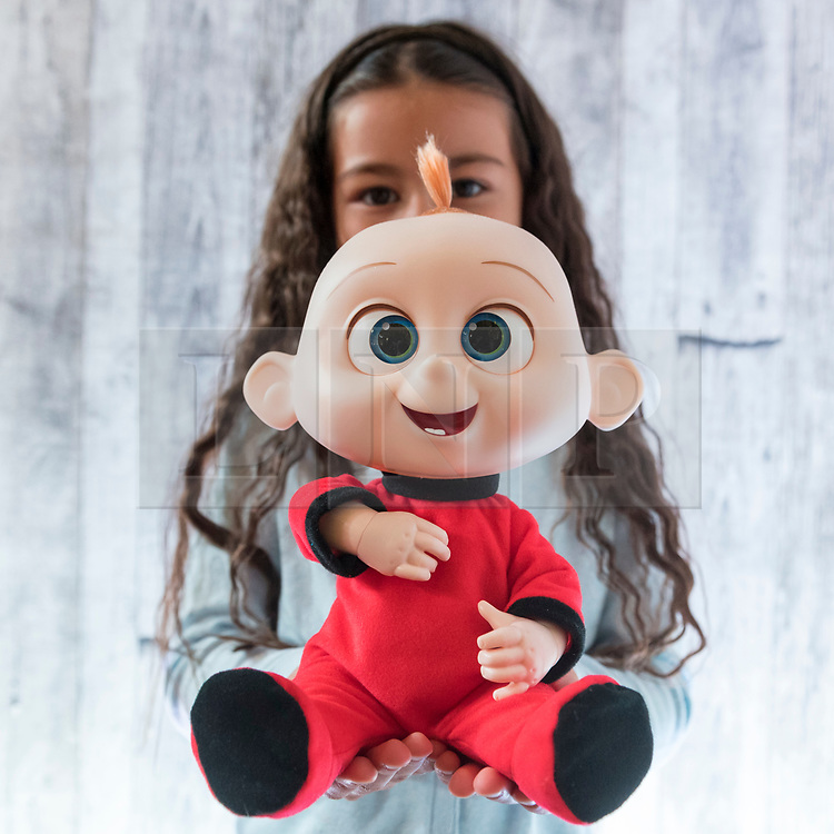 "© Licensed to London News Pictures. 14/11/2018. LONDON, UK. Ayva, aged 6, plays with Jack-Jack Attacks from Incredibles 2 by Disney. Preview of ""DreamToys"", the official toys and games Christmas Preview, held at St Mary's church in Marylebone.  Recognised as the countdown to Christmas, the Toy Retailer's Association, an independent panel of leading UK toy retailers, have selected the definitive and most authoritative list of what toys will be the hottest property this Christmas. [Child models provided by show organisers, permission obtained to be photographed].  Photo credit: Stephen Chung/LNP"