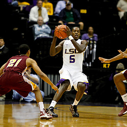 Jan 5, 2013; Baton Rouge, LA, USA; LSU Tigers forward Shavon Coleman (5) is defended by Bethune-Cookman Wildcats guard Kevin Dukes (21) and guard Malik Jackson (10) during the first half of a game at the Pete Maravich Assembly Center. Mandatory Credit: Derick E. Hingle-USA TODAY Sports