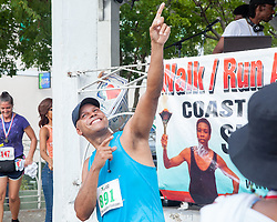 VI Walk/Run Against Gun Violence overall winner Antonio Maysonet celebrates his win.  Virgin Islanders gear up for the 2-mile Virgin Islands Walk/Run Against Gun Violence along the Charlotte Amalie Waterfront.   Proceeds from the event go to benefit the Jason Carroll Memorial Fund for college scholarships.  St. Thomas, VI.  22 May 2016.  © Aisha-Zakiya Boyd