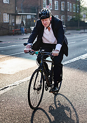 © Licensed to London News Pictures. 30/03/2019. London, UK. Former foreign secretary Boris Johnson cycles in south London the day after Prime Minister Theresa May was defeated for a third time on the Withdrawal Agreement in Parliament. Photo credit: Peter Macdiarmid/LNP