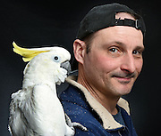 Photo by Mara Lavitt -- Special to the Hartford Courant<br /> March 21, 2015, Middletown<br /> The eighth FeatherFest was held in Middletown by the Connecticut Parrot Society providing visitors with education about parrots and other birds. Michael Brawley of New Britain with his sulphur-crested cockatoo Lenny. He has raised Lenny from a chick but like many at the event he also has more birds at home, both of whom were rescues.