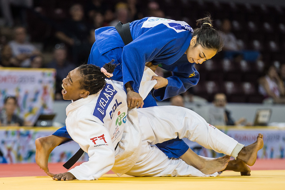 Mariana Silva (Top) of Brazil throws Diana Velasco of Colombia during their bronze medal contest in the women's judo -63kg class at the 2015 Pan American Games in Toronto, Canada, July 13,  2015.  AFP PHOTO/GEOFF ROBINS