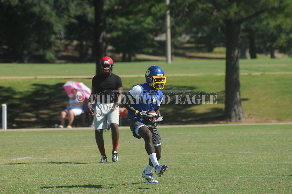 Tommy Knight catches a pass as Oxford High participates in the Mississippi Invitational 7-on-7 Tournament in Tupelo, Miss. on Friday, June 28 and Saturday, June 29, 2013.