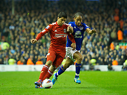 LIVERPOOL, ENGLAND - Tuesday, March 13, 2012: Liverpool's Luis Alberto Suarez Diaz in action against Everton's Steven Pienaar during the Premiership match at Anfield. (Pic by David Rawcliffe/Propaganda)