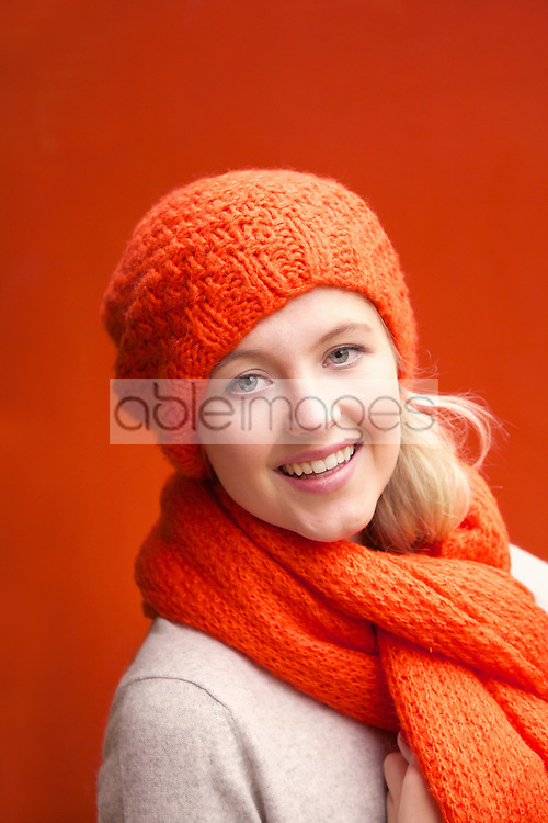 Woman Wearing Wool Hat and Scarf Smiling