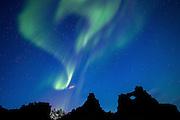 Northern lights over Dimmuborgir in northern Iceland, near Lake Myvatn