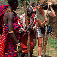 Africa, Kenya, Maasai Mara. Learning to build with Maasai women