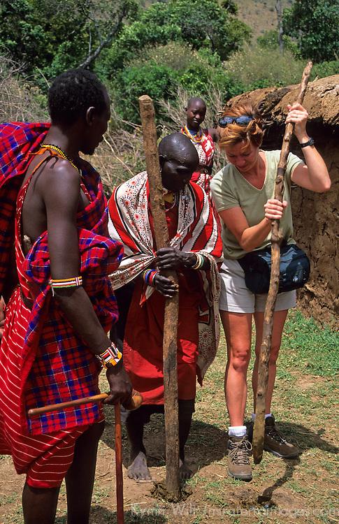 Africa, Kenya, Maasai Mara. Learning to build with Maasai women