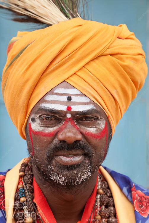 Bearded Sadhu holy man at Hindu temple in the ancient city of Hampi, Karnataka, India